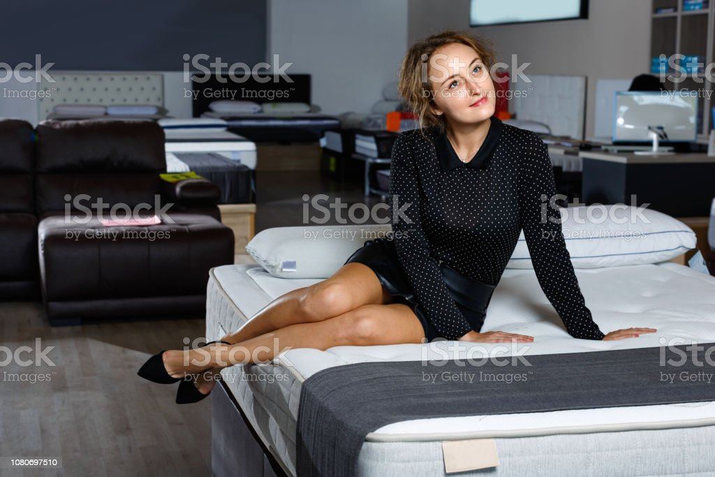Portrait of young glad beautiful sexy woman in black clothes posing...