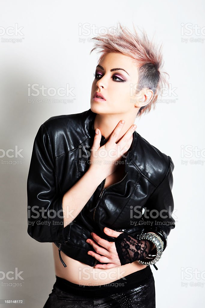 Portrait of young short-haired woman in punk attire stock photo