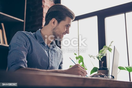istock Portrait of young smart happy student preparing for the exams 944498392