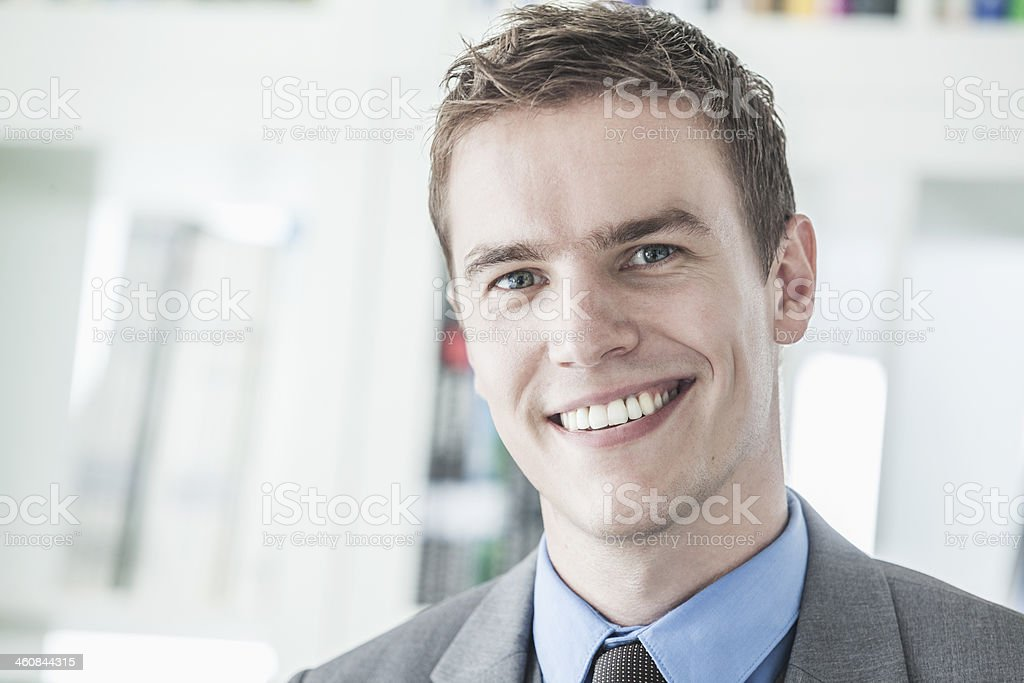 Portrait of young smiling businessman looking at camera stock photo