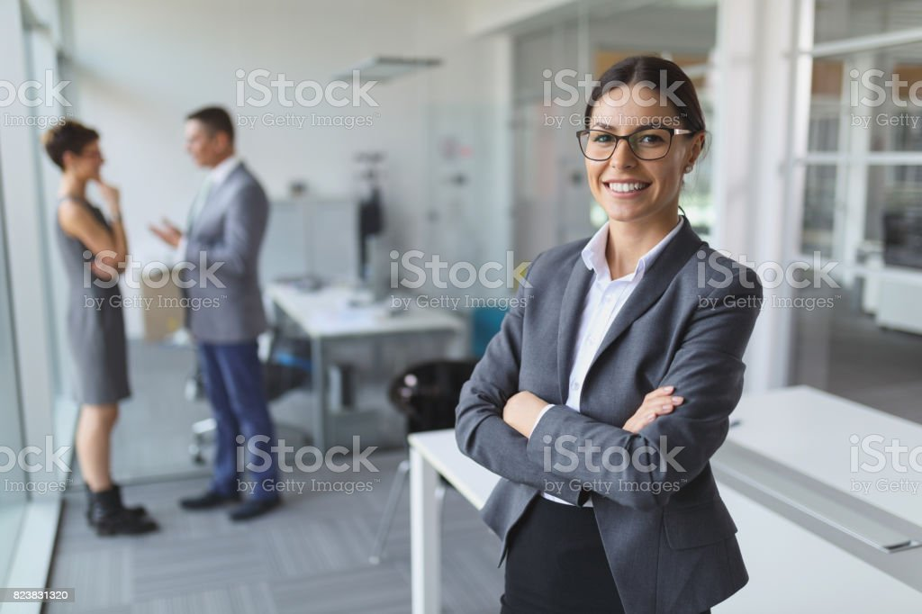 Portrait of young smiling businesswoman in the office stock photo