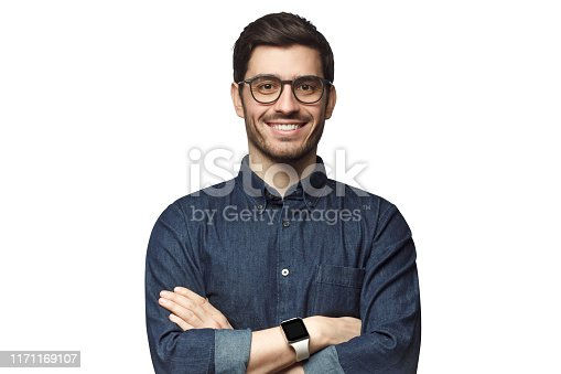 Portrait of young smiling caucasian man with crossed arms, wearing smart watch and casual denim shirt, isolated on white