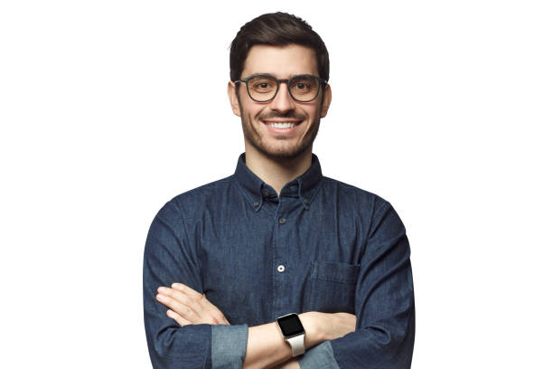 portrait of young smiling caucasian man with crossed arms, wearing smart watch and casual denim shirt, isolated on white - ritratto uomo foto e immagini stock