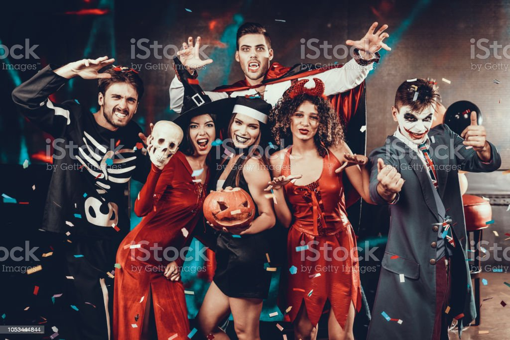 Portrait of Young Smiling People in Scary Costumes stock photo