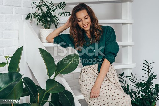 Portrait of young smiling woman at home.