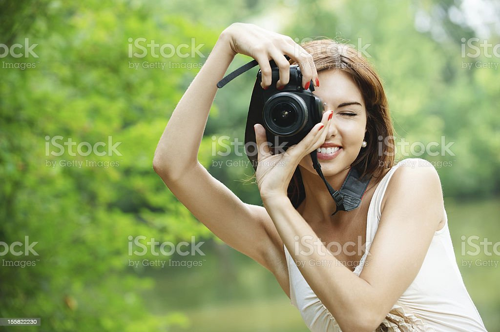 portrait of young smiling woman taking photo royalty-free stock photo