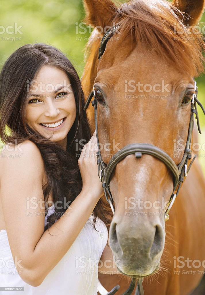 Portrait Of Young Smiling Woman With Horse Stock Photo More