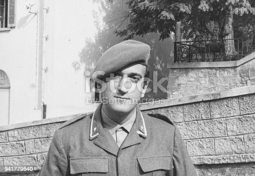 Portrait of young soldier in 1970, black and white photography