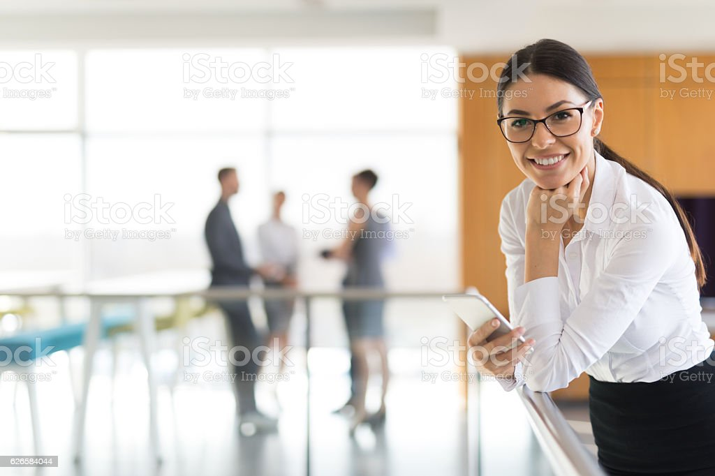 Portrait of young successful businesswoman at work stock photo