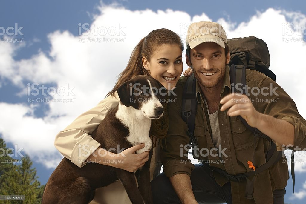 Portrait of young trekker couple with dog royalty-free stock photo