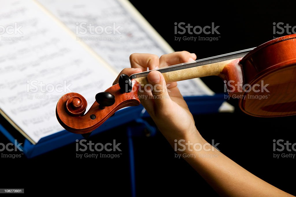 Portrait of young violinist with old and valuable violin.. royalty-free stock photo