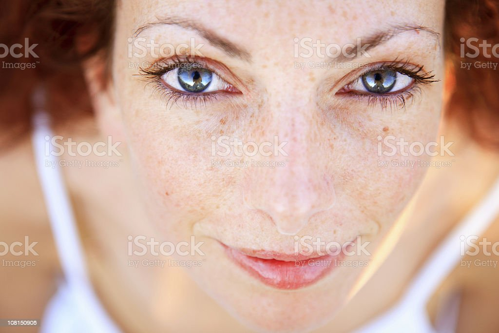Portrait of Young With Freckles Looking Up at Camera stock photo
