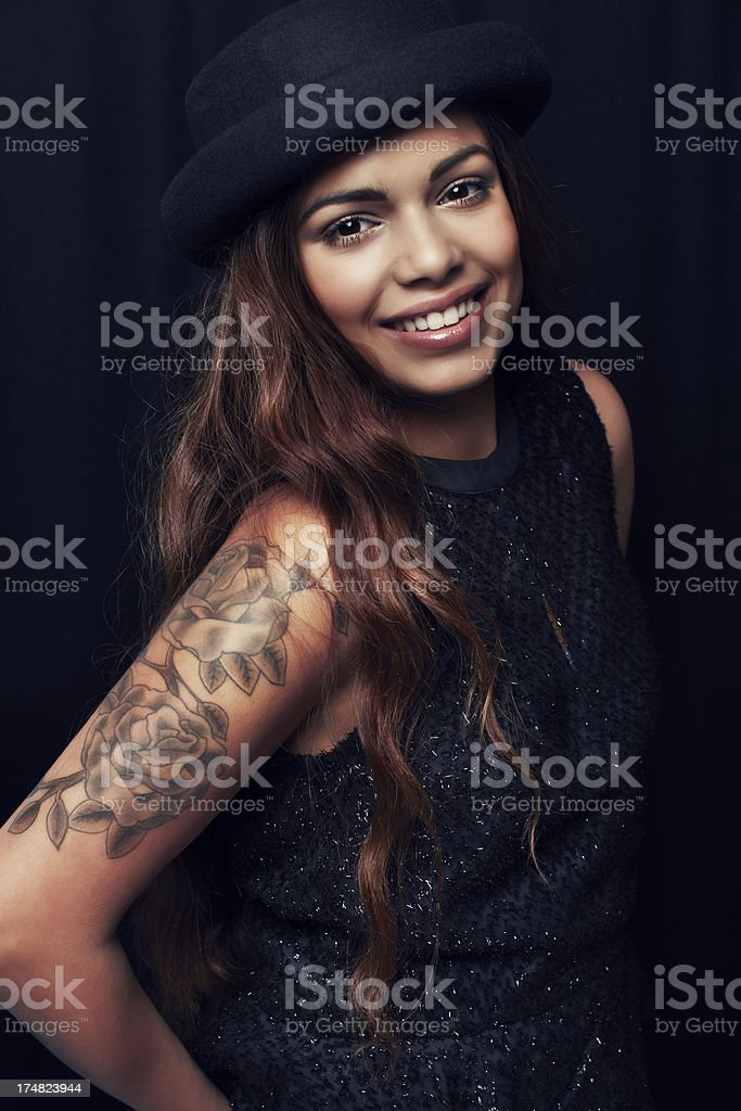 Portrait of young woman against black background royalty-free stock photo