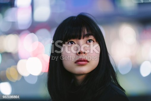 istock Portrait of young woman at night 932096864