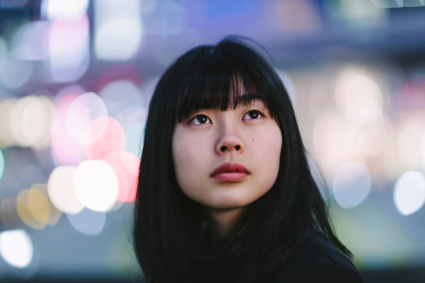 portrait of young woman at night - east asian ethnicity stock photos and pictures
