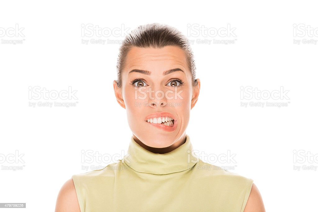 Portrait of young woman biting lips stock photo