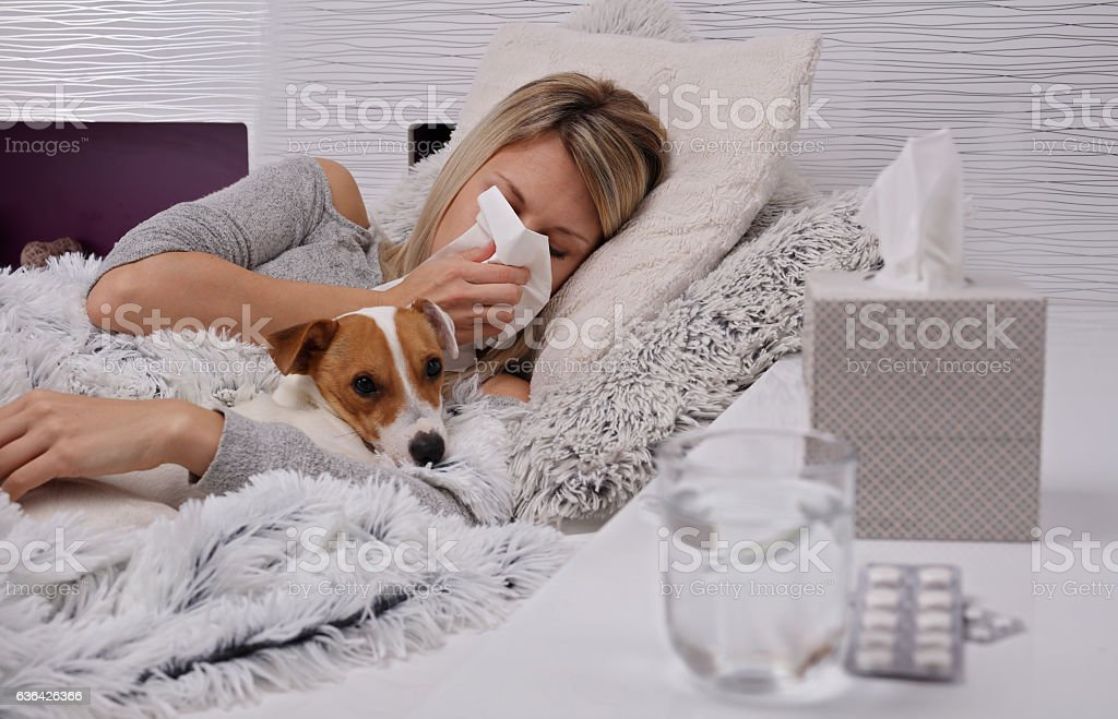 Portrait of young woman blowing nose. Flu, cold, headache stock photo