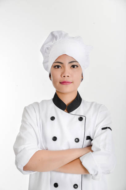 Portrait of young woman chef isolated stock photo