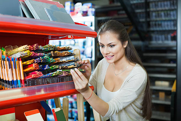 Portrait of young  woman choosing pencils for drawing stock photo