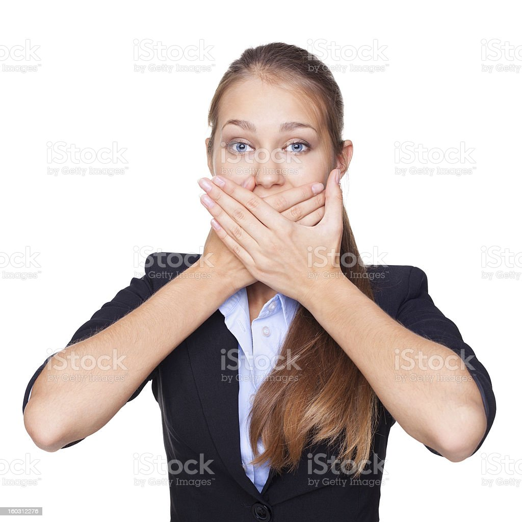 Portrait of young woman covering mouth with her hands isolated royalty-free stock photo