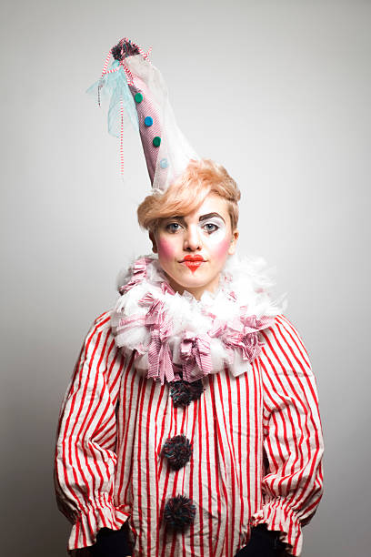 Portrait of Young Woman Dressed as Clown stock photo
