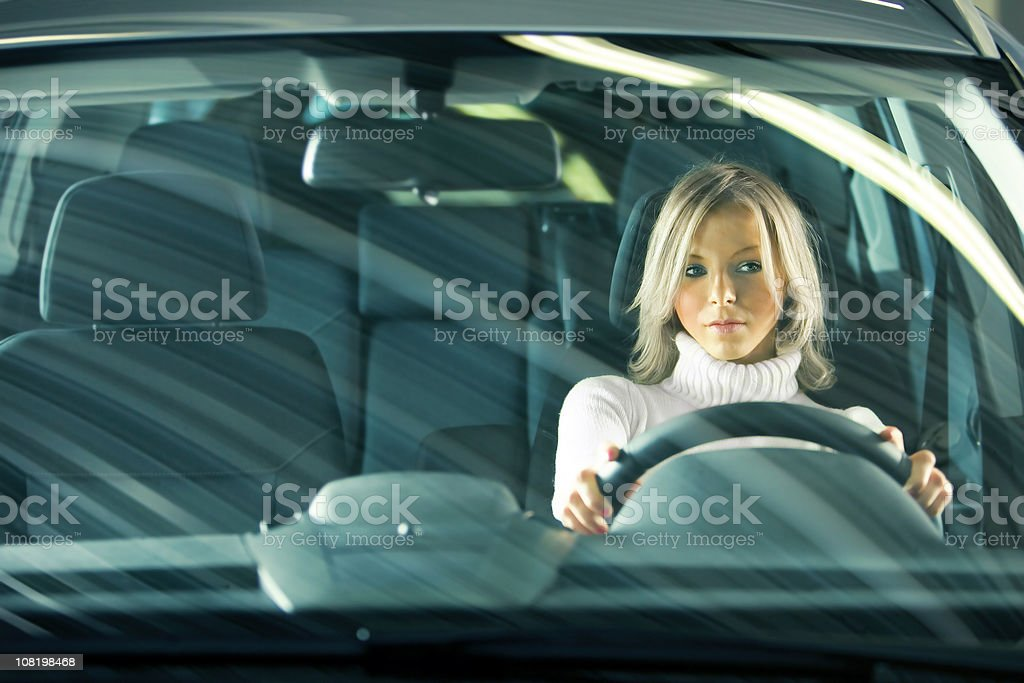 Portrait of Young Woman Driving Car royalty-free stock photo