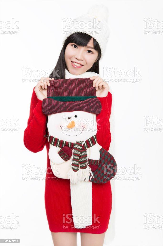 Büyük bir Noel çorap tutan genç kadın portresi stok fotoğrafı