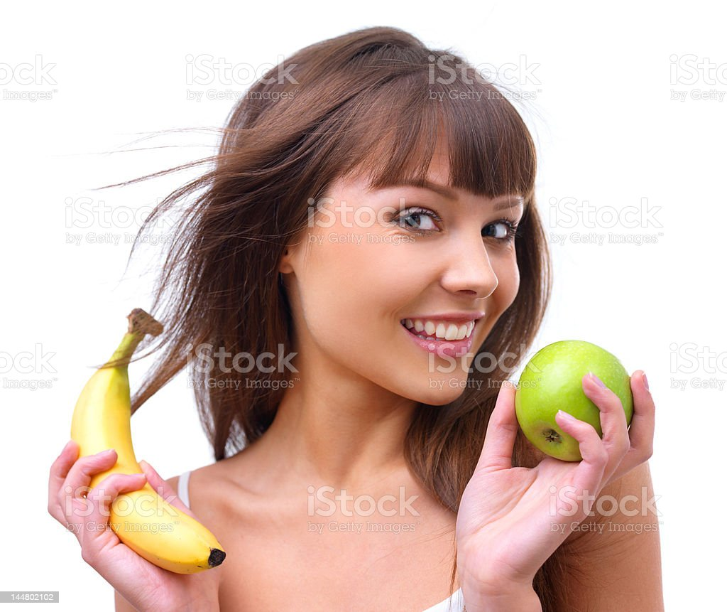 Portrait of young woman holding an apple and banana royalty-free stock photo