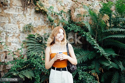 531098549 istock photo Portrait of young woman holding coffee 1175720426