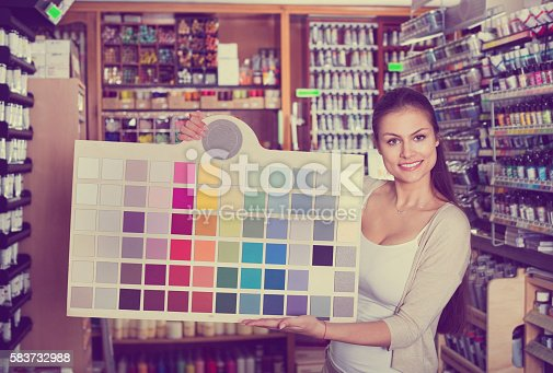 594918592 istock photo Portrait of young woman holding color sample palette 583732988