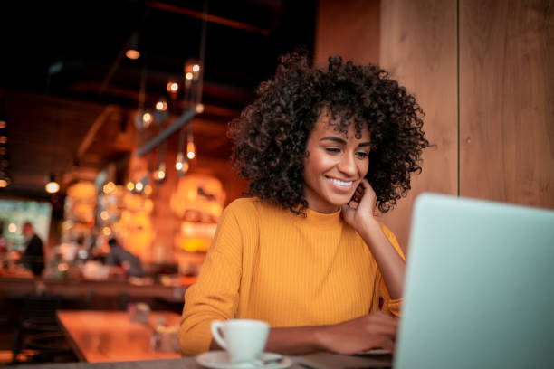 Portrait of young woman in a coffee shop stock photo