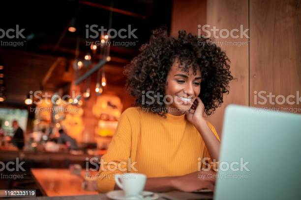 Portrait Of Young Woman In A Coffee Shop Stock Photo - Download Image Now