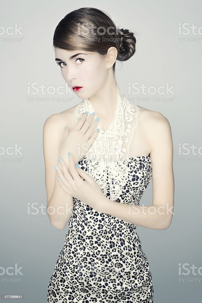 Portrait of young woman in a leopard print dress. stock photo