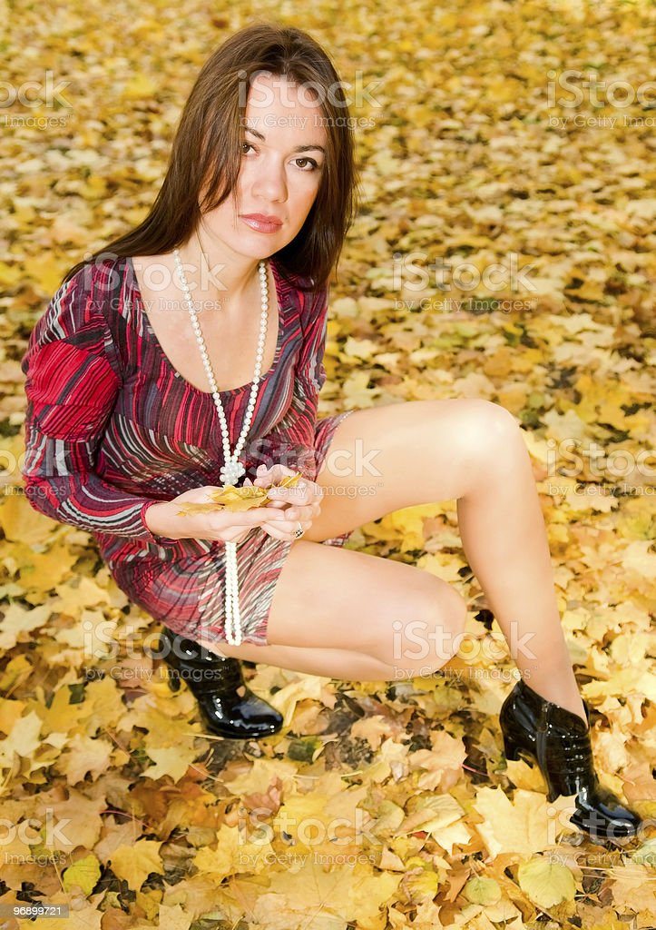 portrait of young woman in autumn park royalty-free stock photo