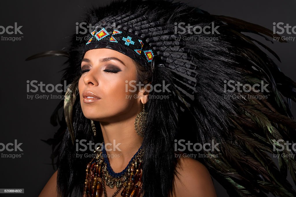 Portrait of young woman in costume of  American Indian stock photo