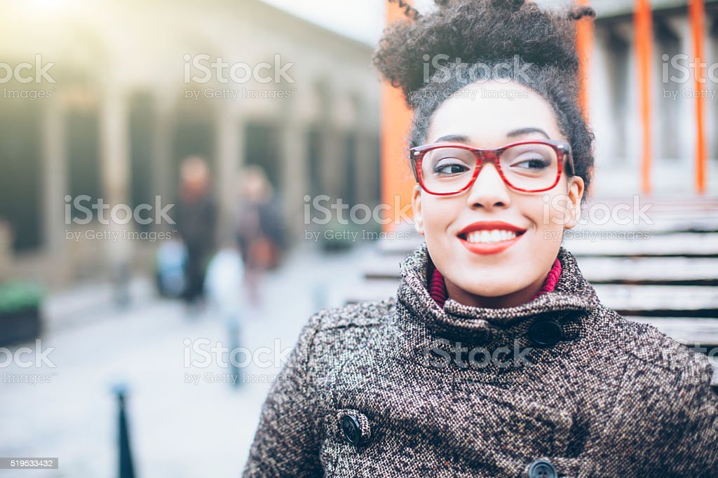 Portrait of young woman in front of a building stock photo