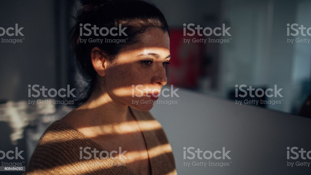 Portrait of young woman in her apartment stock photo