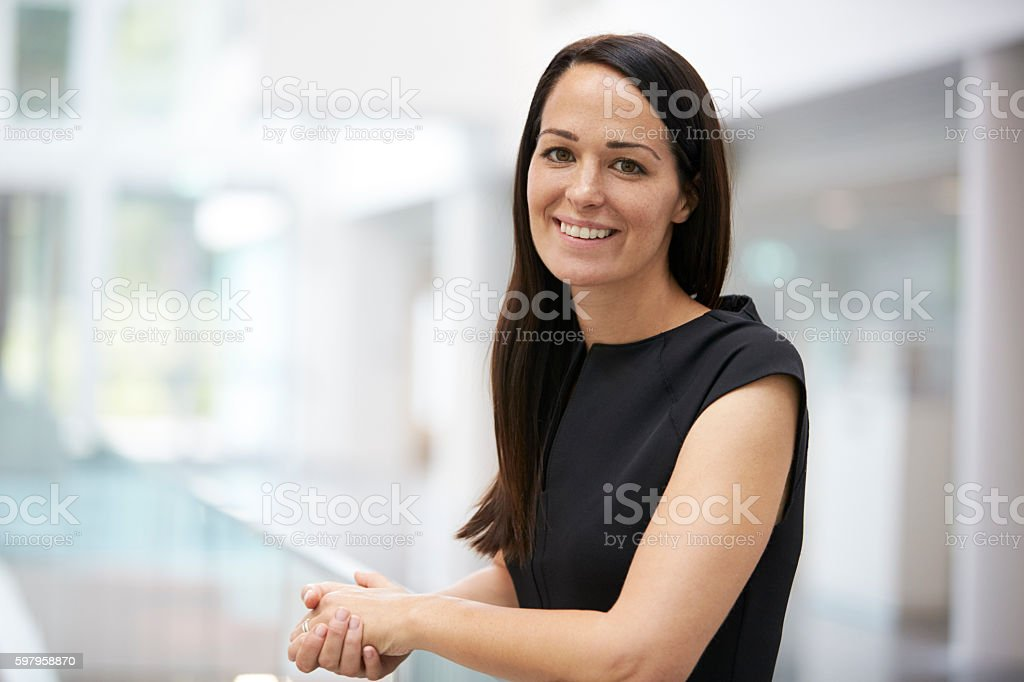 Portrait of young woman in modern university interior stock photo