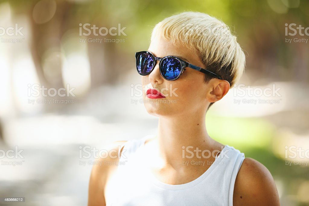 Portrait of young woman in nature stock photo