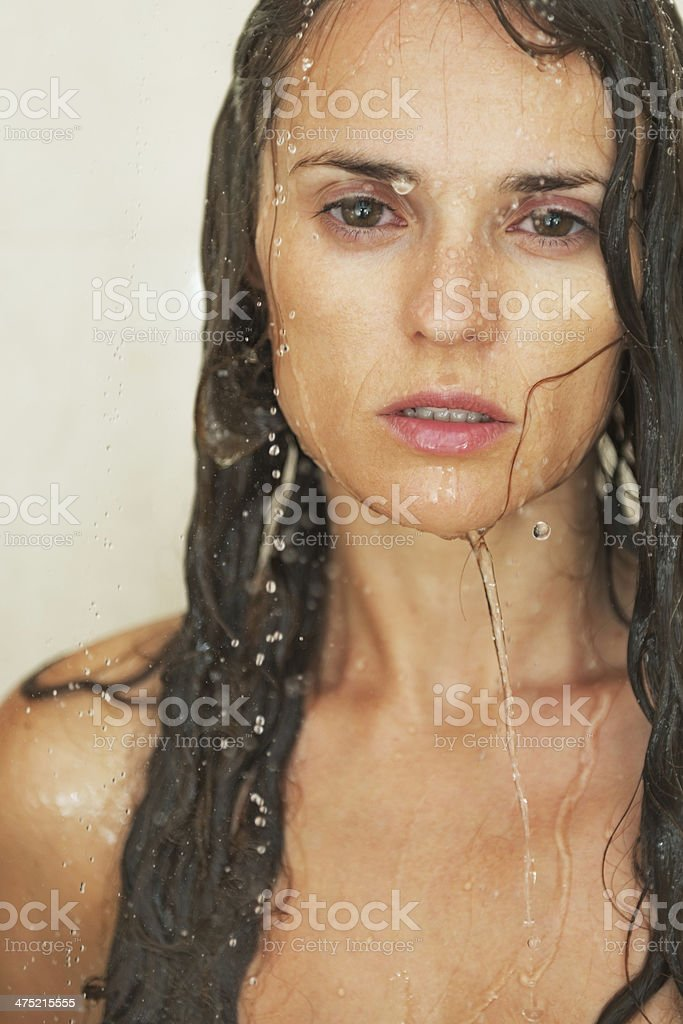 portrait of young woman in shower royalty-free stock photo