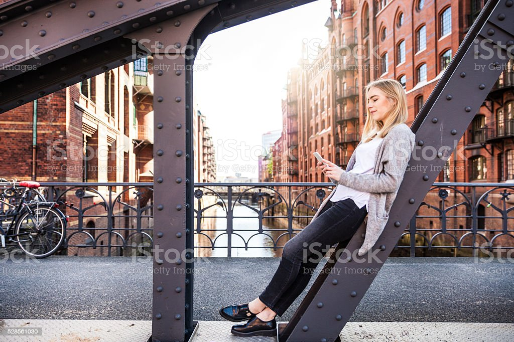 Portrait of young woman in the city stock photo