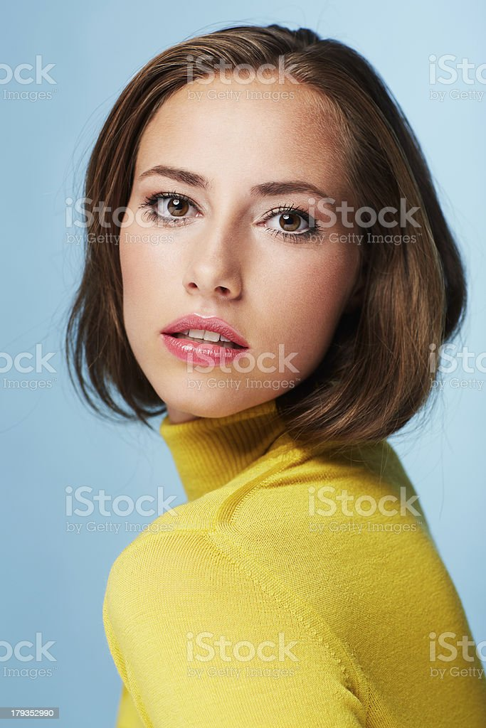 Portrait of young woman in yellow polo neck stock photo