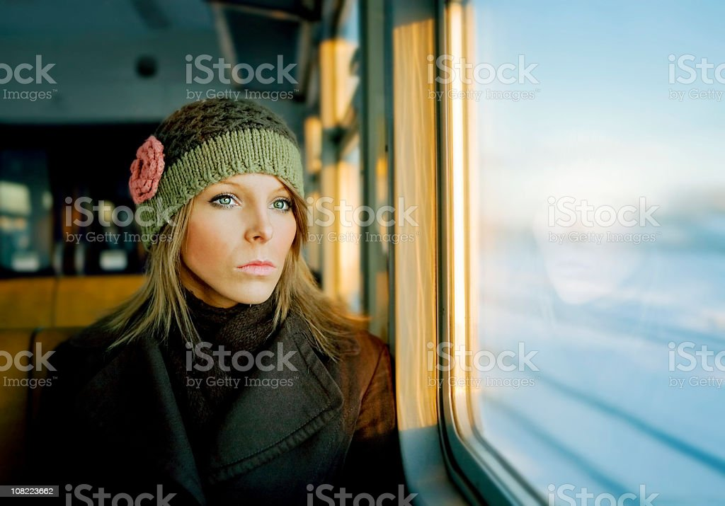 Portrait of Young Woman Looking Out Train Window royalty-free stock photo