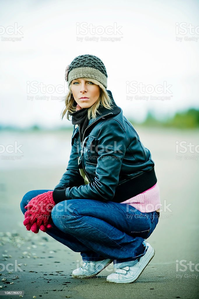 Portrait of Young Woman on Beach During Cold Day royalty-free stock photo