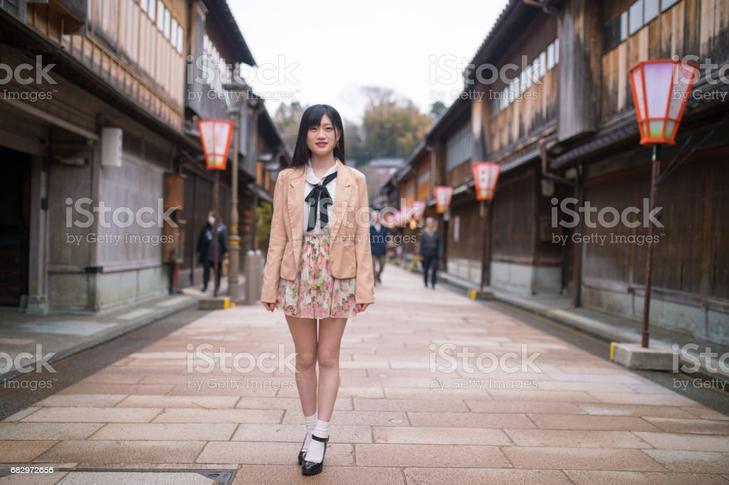 Portrait of young woman  on raditional Japanese shopping street royalty-free stock photo