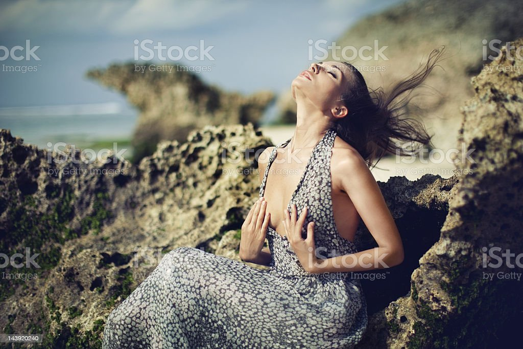 Portrait of Young Woman on Rocks royalty-free stock photo