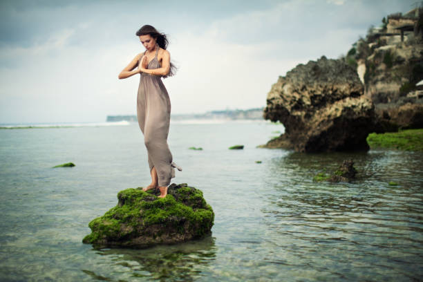 Portrait of Young Woman on Rocks stock photo