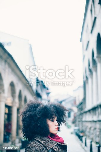 518885222istockphoto Portrait of young woman on street 519585652