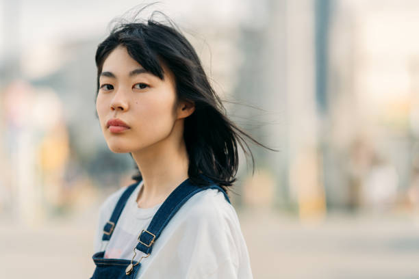 Portrait of young woman on windy day stock photo