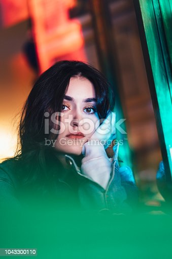 istock Portrait of young woman 1043300110